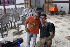 The little boy who gives the best hugs with one of my team members.